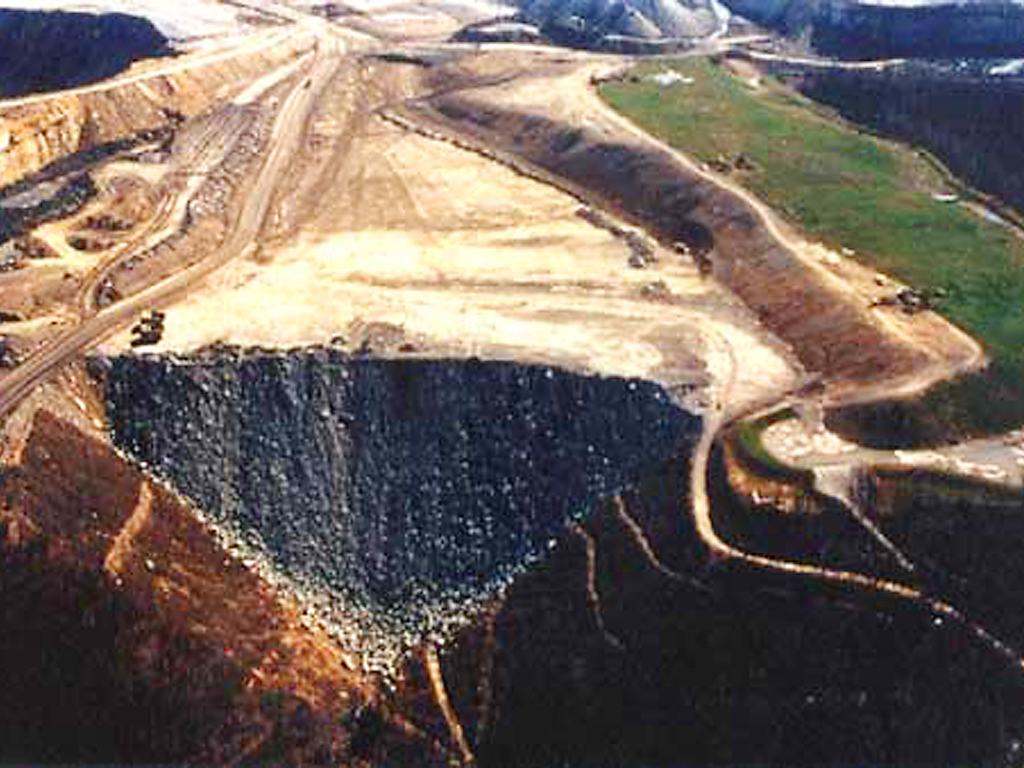 Devastated land scraped bare with tons of toxic waste flowing downhill from mountaintop removal.